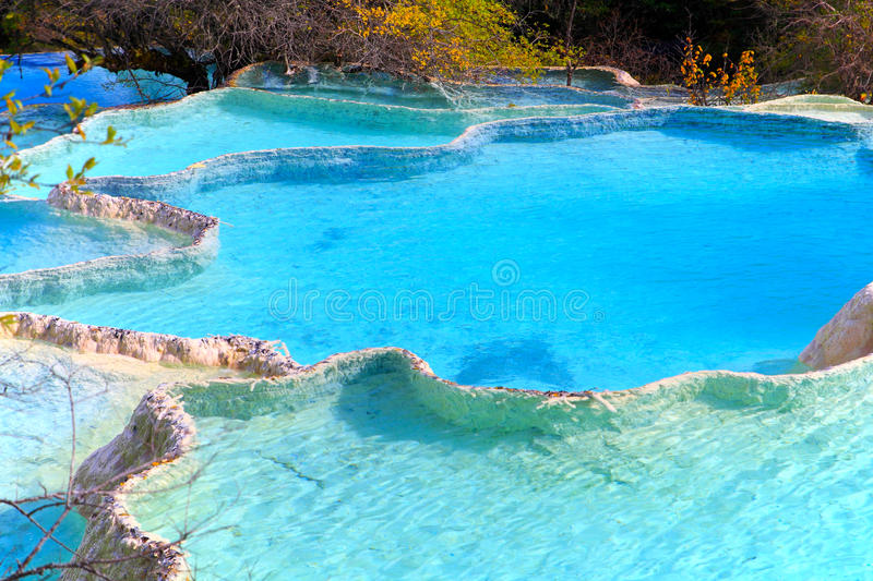 Limestone pools. Colorful ponds in Huanglong nature protection area, Sichuan province, South-West China.Huanglong Scenic area is located in Songpan County royalty free stock images