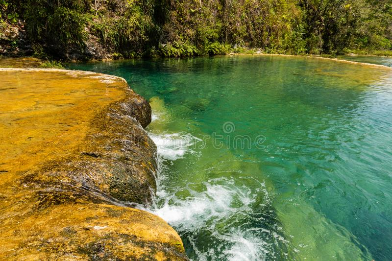 Limestone ridge with cascades and waterfalls of Semuc Champey in the Peten jungle and rainforest of Guatemala royalty free stock photography