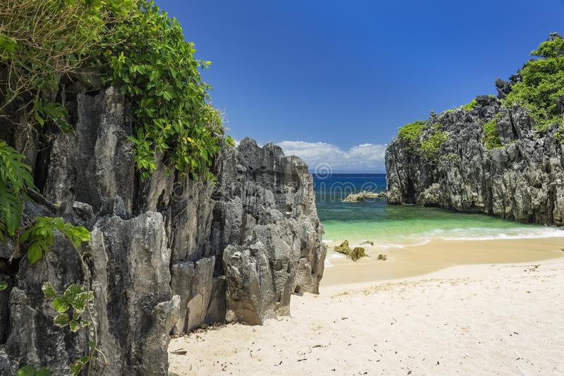 Limestone rock formation on Lahus Island beach, Caramoan, Camarines Sur Province, Luzon in the Philippines. Limestone rock formation on Lahus Island beach in the stock photography
