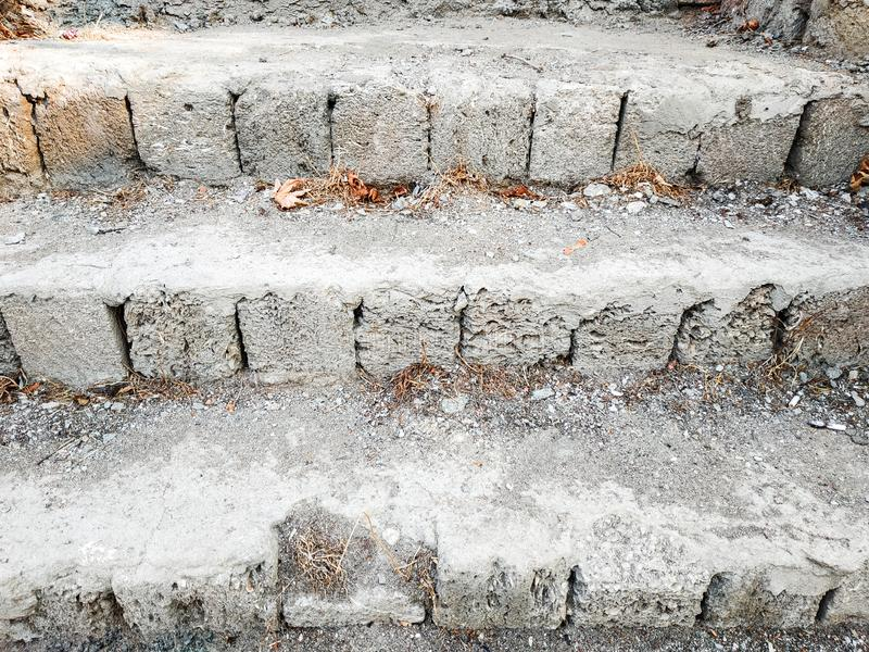 Limestone steps in front of unfinished house stock image