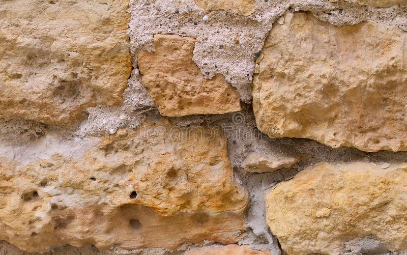Limestone wall. With cement as a background stock photography