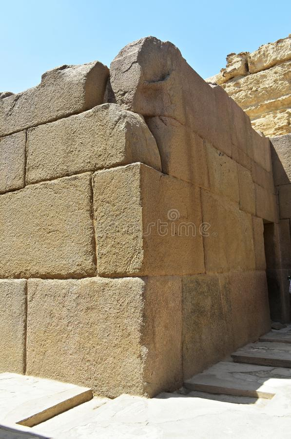 Limestone wall in Valley Temple of Khafre at Giza, Egypt. Limestone wall within the Valley Temple of Khafre, also known as the `Granite Temple`. Khafre`s temple royalty free stock image