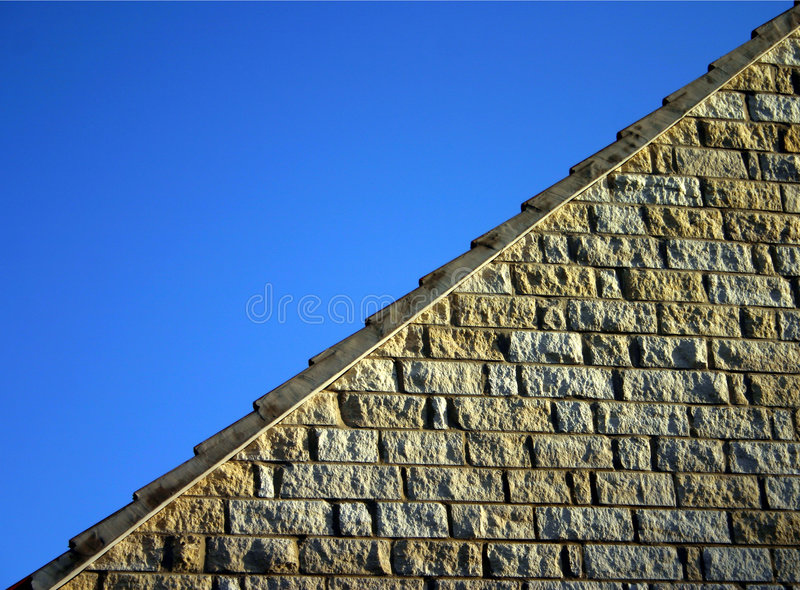 Limestone Walling. A section of limestone wall neatly diagonally disecting a blue sky stock photography