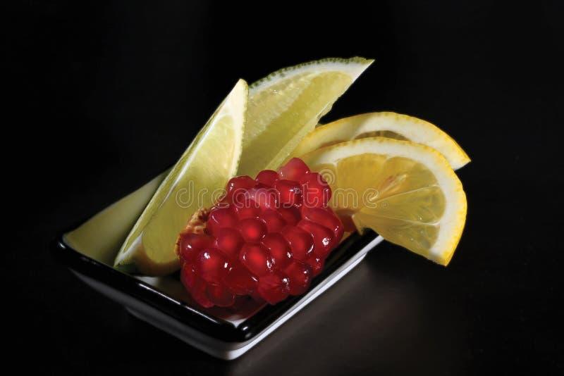 Limetta e limone del granato fotografie stock libere da diritti