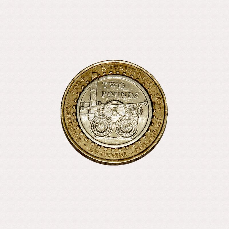 Richard Trevithick Pennydarren Industrial revolution £2 coin. Limited edition British £2 coin commemorating Richard Trevithick first steam engine the royalty free stock photos