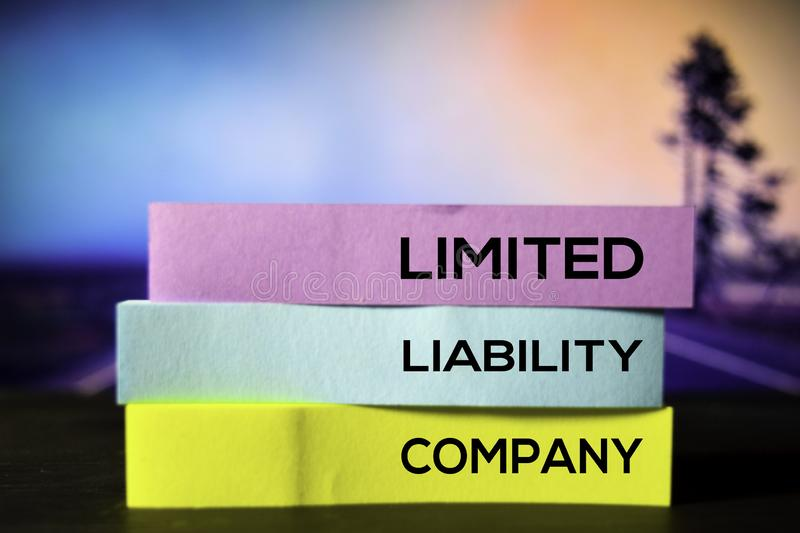 Limited Liability Company on the sticky notes with bokeh background stock photos