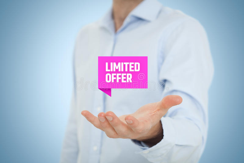 Limited offer. Concept - exclusive business model and marketing offer. Businessman hold virtual label with text stock photography