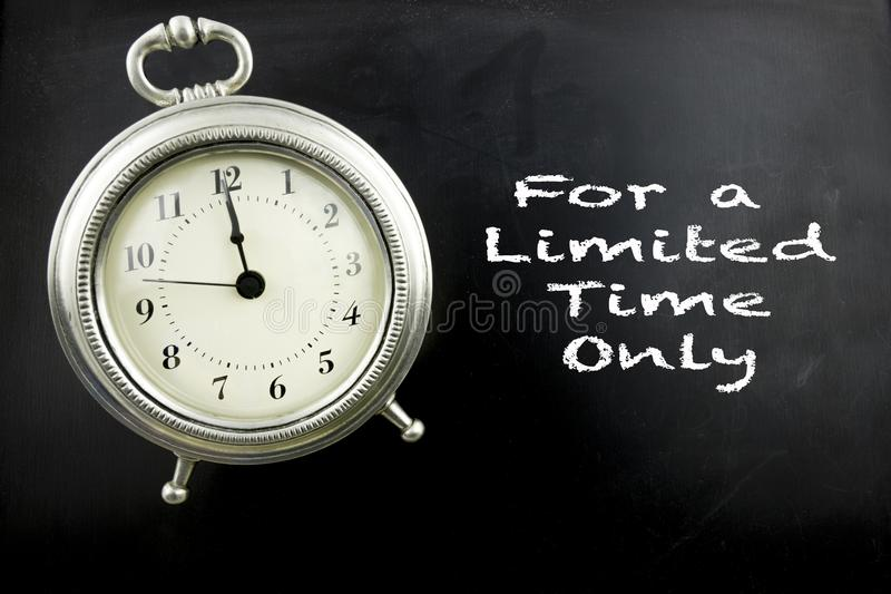For a limited time only on blackboard. Pewter antique alarm clock with for a limited time only on blackboard with copy space vector illustration