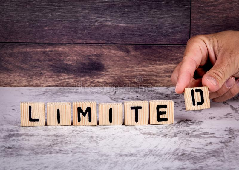 Limited. Word from wooden letters stock photography
