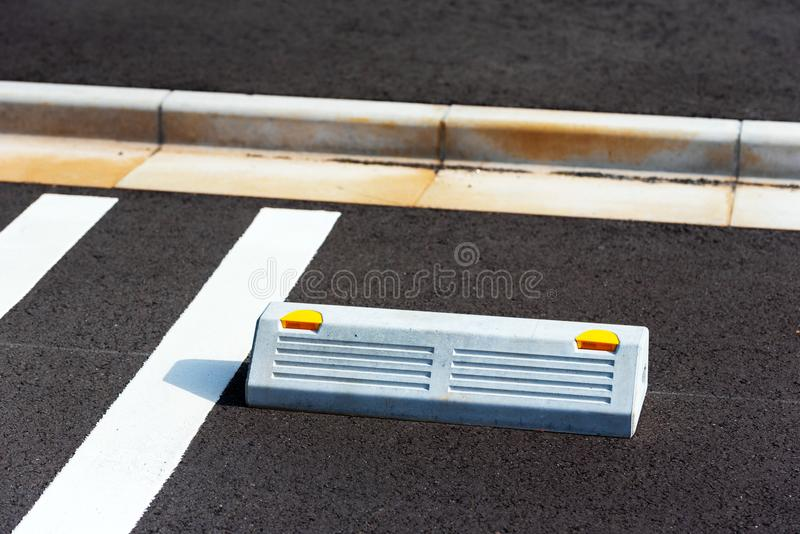 Limiter for vehicle wheels in the parking space, Hanoke, Japan. Copy space for text. Limiter for vehicle wheels in the parking space, Hanoke, Japan. Copy space stock photo