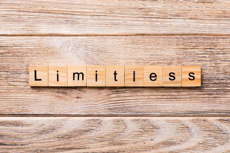 Limitless word written on wood block. Limitless text on wooden table for your desing, concept stock images