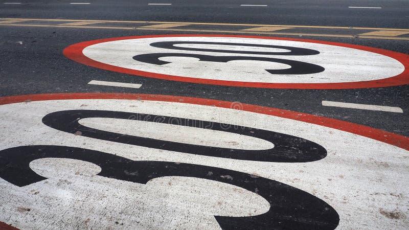 Limits do not drive speed cars 30 km symbol painted on the street. Limits do not drive speed cars 30 kilometers per Hours symbol painted on the street stock photo