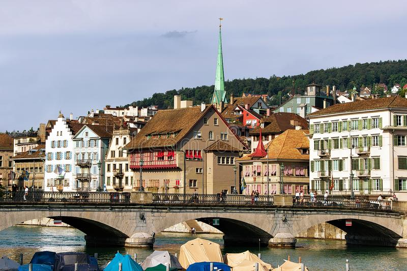 Limmat River and spire of Predigerkirche in city center Zurich. Limmat River and spire of Predigerkirche in the city center of Zurich, Switzerland royalty free stock image