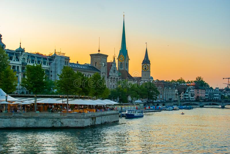Limmat river and Zurich at sunset stock images