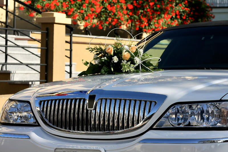 Limo. White Limo decorated with flowers awaiting for newly married royalty free stock photo