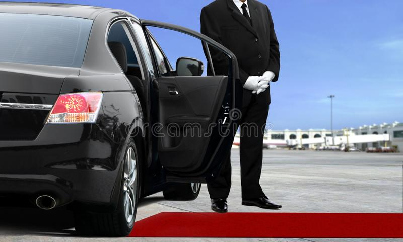 Limo driver waiting at the airport. Runway royalty free stock photography
