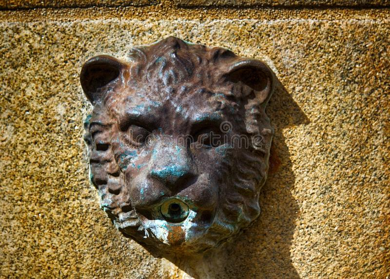 Medallions of lions fountain in the city. Limoges, France - September 28, 2017: Medallions of lions fountain in the city. Relief medallion Leo stock images