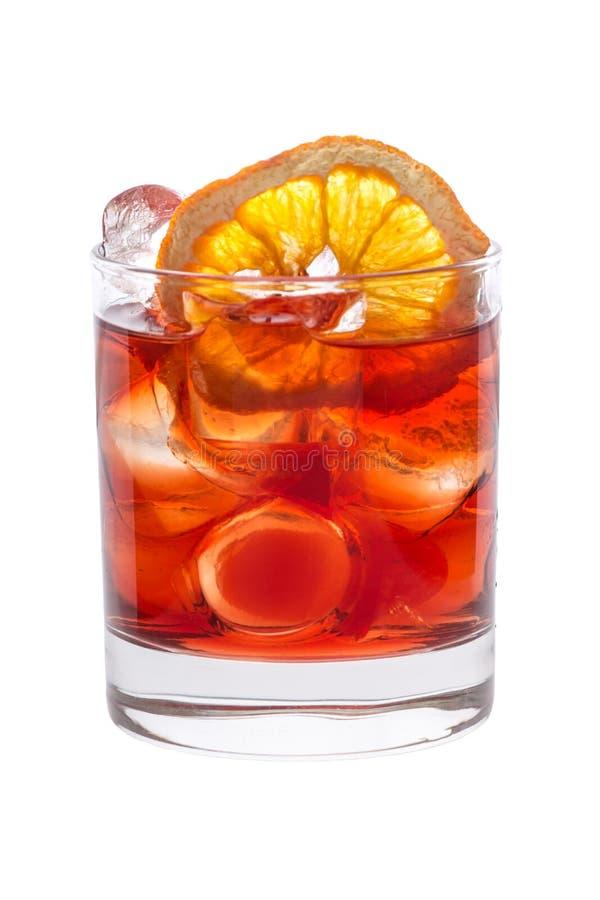 Limonada roja y anaranjada de la fruta con el primer del hielo fotografía de archivo