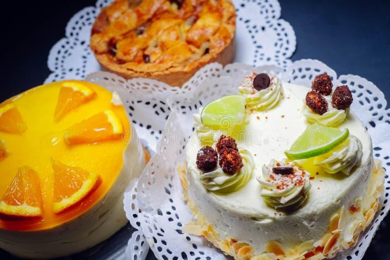 Limoncello cake, orange cheese cake and apple pie royalty free stock photo