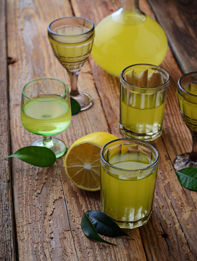 Limoncello, Italian liqueur with lemons royalty free stock image