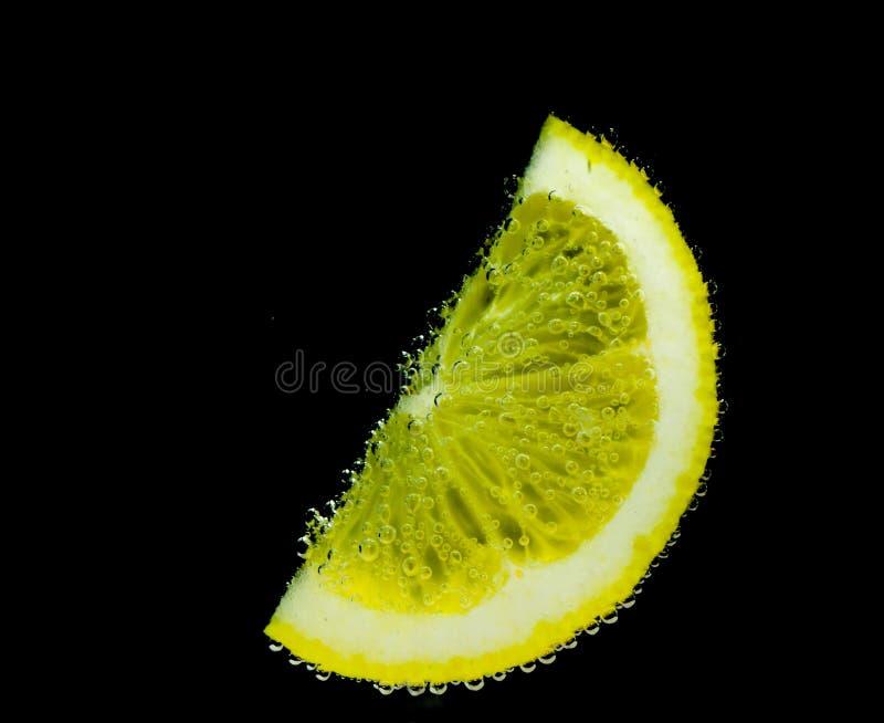 Limone con le bolle immagine stock
