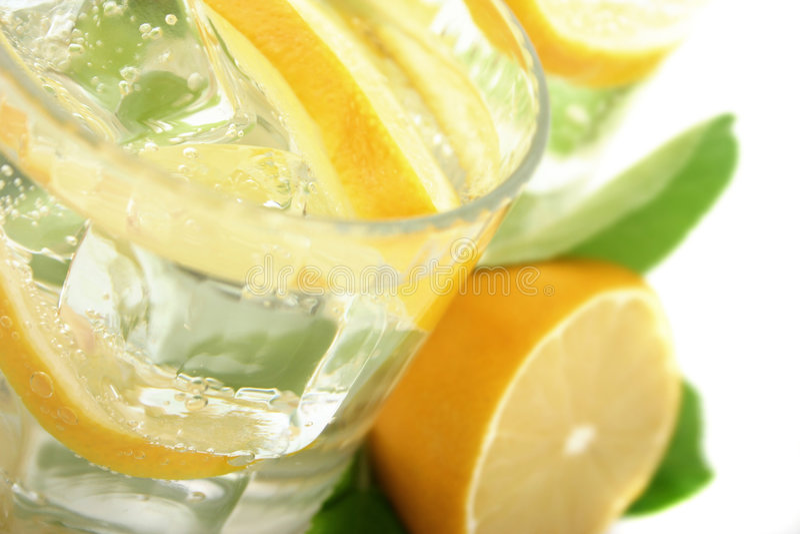 Limone in soda fotografia stock