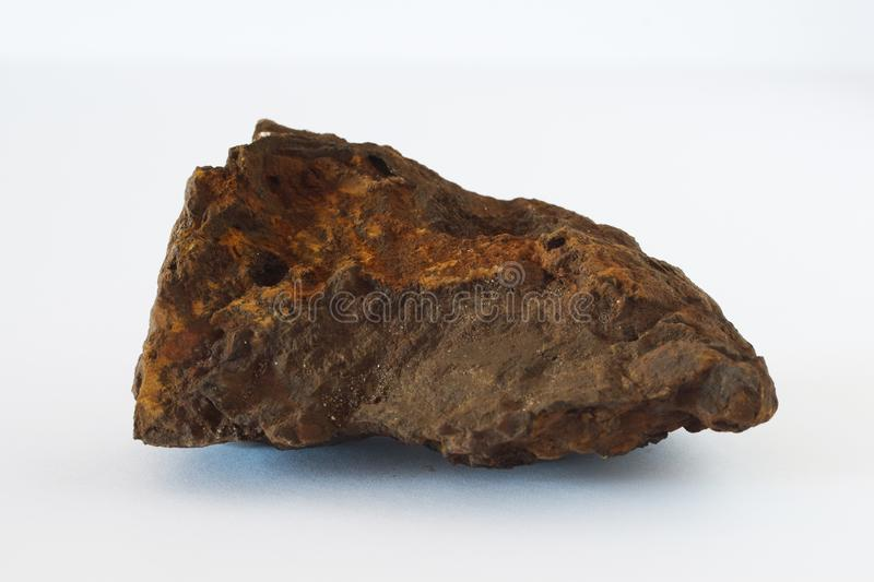 Limonite mineral also iron ore on white background. Potentially for economic and metal market prices news stock photo