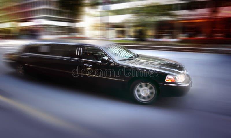 Limosine driving down street. (blurred motion), evening stock photos