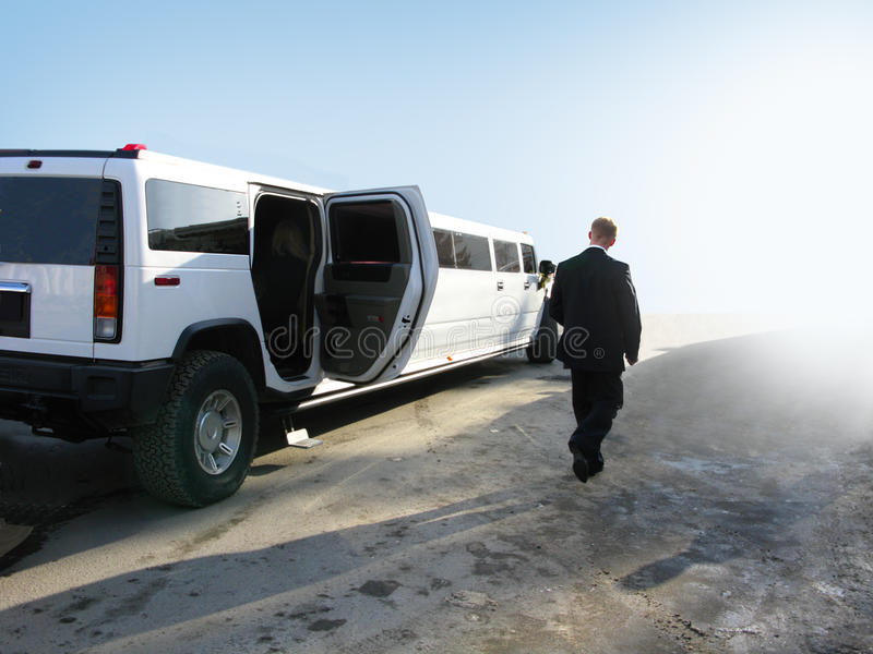 Limousine. White limousine and the security guard stock images