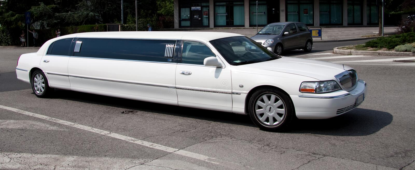 Limousine. Wedding limousine driving on the road stock photos
