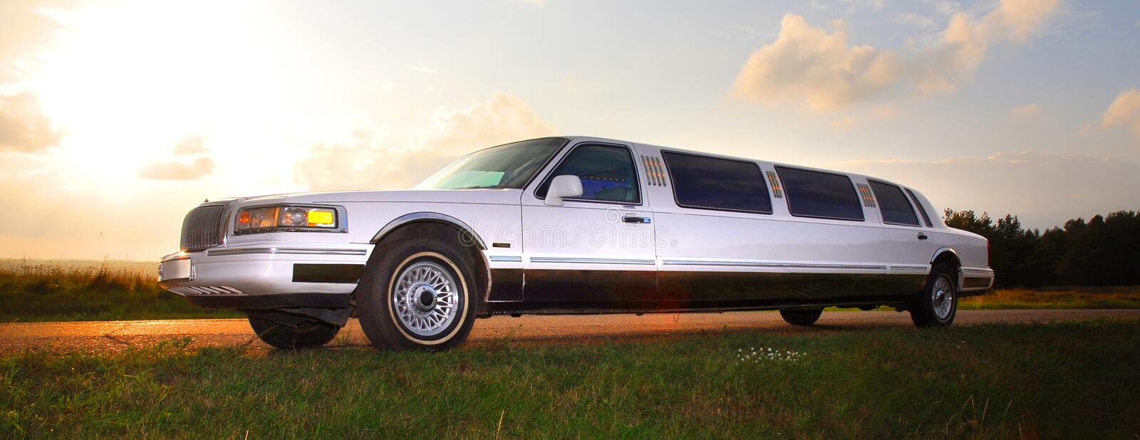 Limousine. Wedding White Limousine in the Sunset royalty free stock images