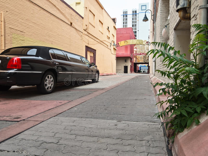Limousine in a back alley. Limousine waits in an urban back alley royalty free stock photos