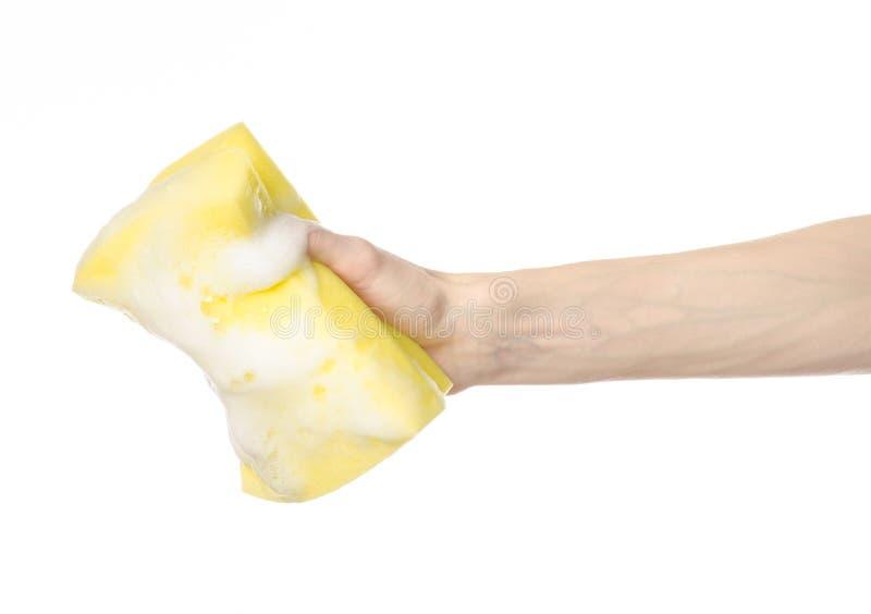 Limpando o assunto da casa e do saneamento: Mão que guarda um s amarelo fotografia de stock
