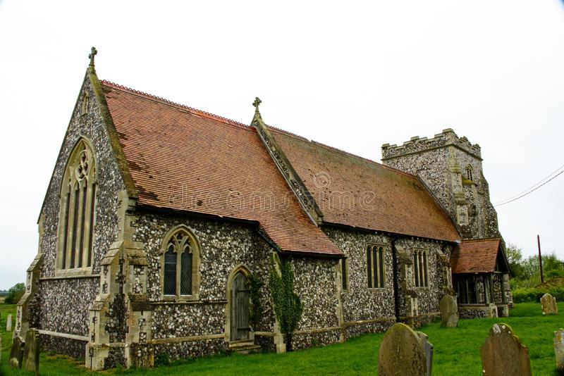 Limpenhoe village church, Norfolk. St Botolph church in the Norfolk village of Limpenhoe was almost completely rebuilt around 1880 although the tower survives royalty free stock photography
