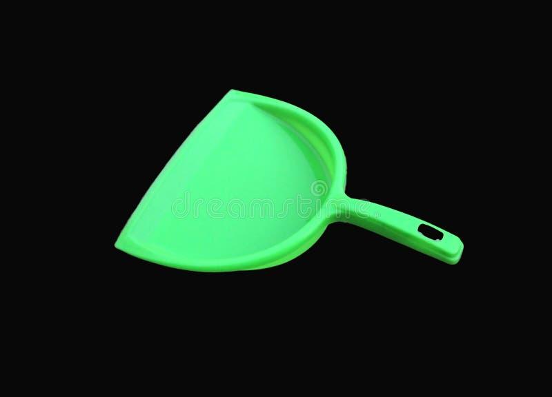 Limpiador verde de la basura aislado en fondo negro fotografía de archivo libre de regalías