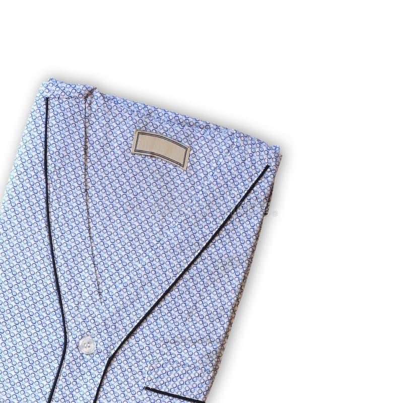 Limpie el pijama del hombre doblado Aislado en blanco fotografía de archivo