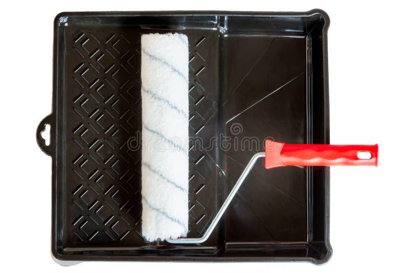 Limpie el rollo en una bandeja plástica negra imagenes de archivo