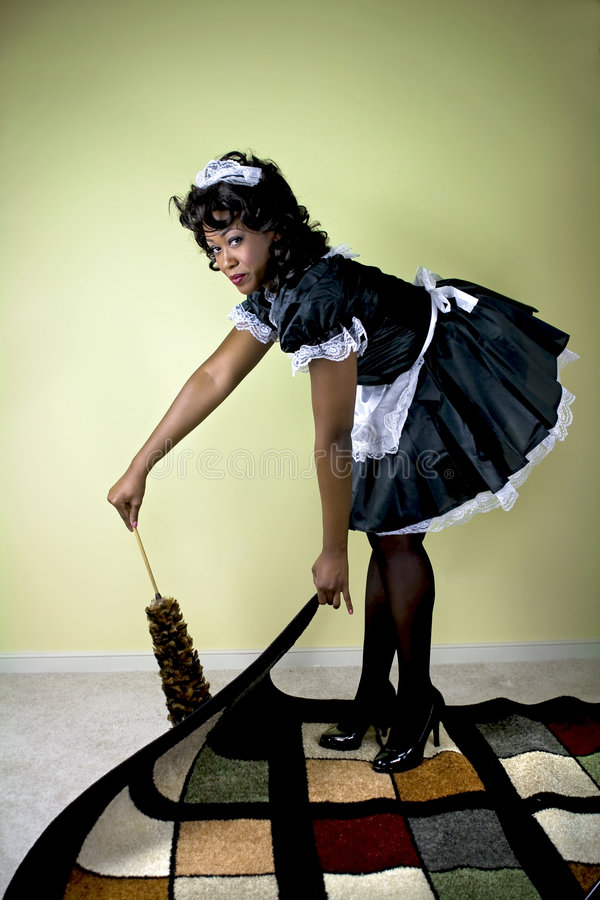 Limpieza de la criada foto de archivo libre de regalías