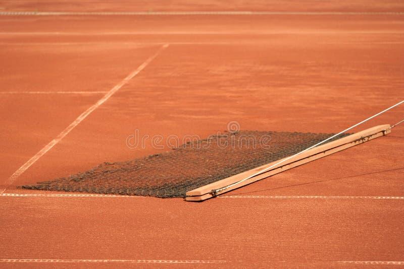 Limpieza del campo de tenis fotos de archivo libres de regalías