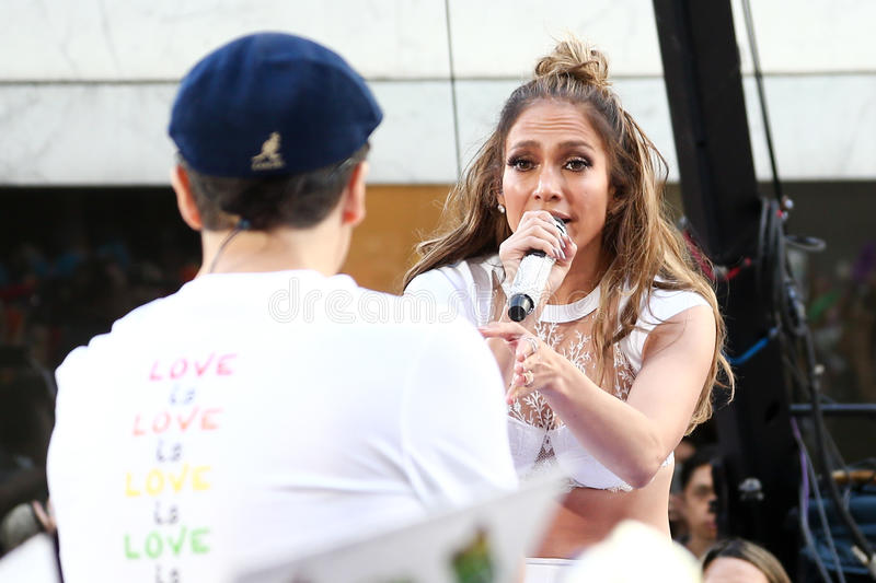 Lin-Manuel Miranda, Jennifer Lopez. NEW YORK-JULY 11: Lin-Manuel Miranda (L) and Jennifer Lopez perform onstage at NBC's Today Show at Rockefeller Plaza on July stock image