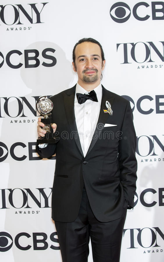 Lin-Manuel Miranda Wins at 70th Annual Tonys. Multi-talented Lin-Manuel Miranda holds his precious statuette in the Winners Media Room at the JCC on Amsterdam stock images