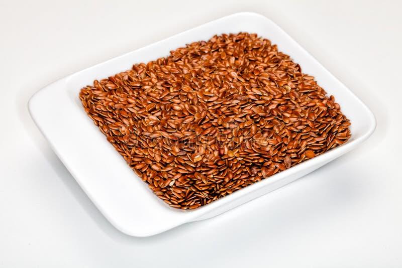 Lin, semences d'oeillette image stock