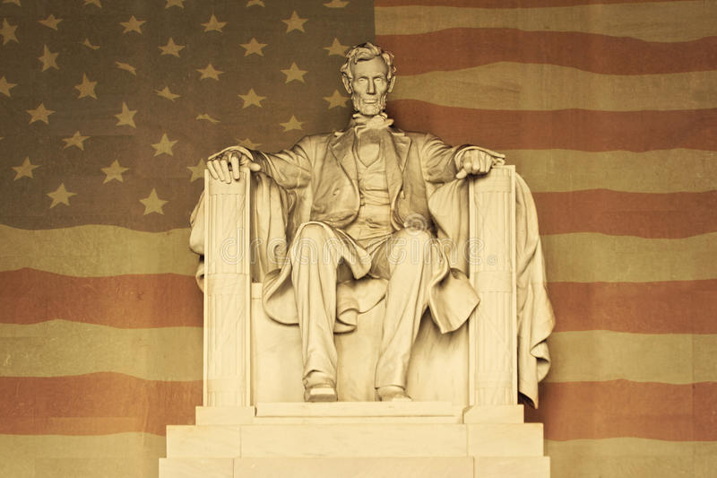 Lincoln with American flag. Statue of Abraham Lincoln at Lincoln memorial, against an American flag royalty free stock photography