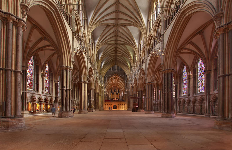 Lincoln Cathedral Nave. This interior view of the nave in Lincoln cathedral shows the impressive grandeur of this medieval building stock photos