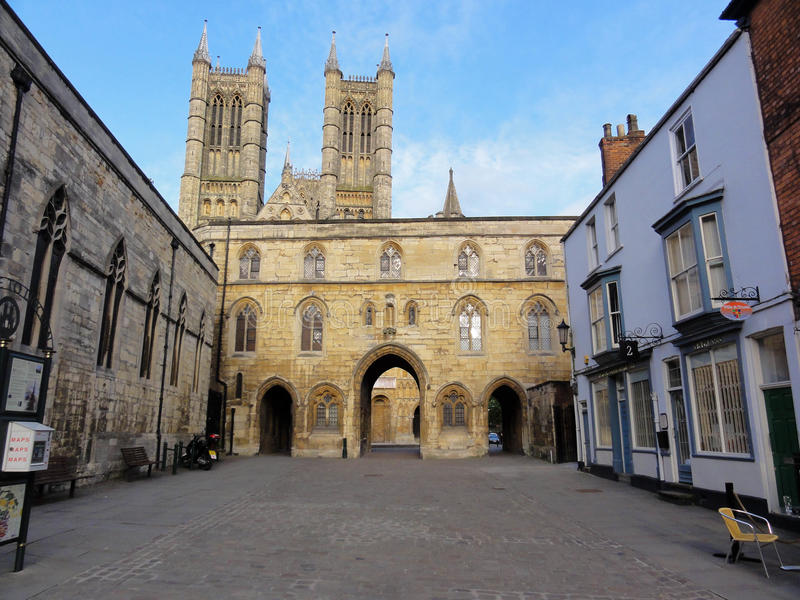 Lincoln Cathedral from Castle Square. Towers of Lincoln cathedral taken from Castle Square architecture archway building church cobbles gothic historic norman royalty free stock photos