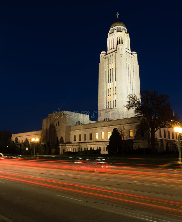 Lincoln Nebraska Capital Building Government Dome Architecture. Cars Sreak By at Night in front of Lincoln Nebraska State Capital Building stock images