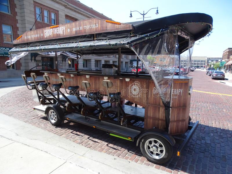 A street car designed for 12 tourist to peddle around town as a tourist attraction. Lincoln, Nebraska/United States-June 29, 2018: A street car designed for 12 stock photos