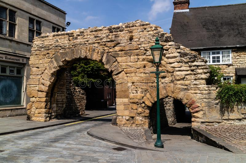 Lincoln, United Kingdom - 07/21/2018: Newport Arch in Lincoln i. N the UK, an old Roman arch that is reputedly the oldest to be used by traffic in the UK. Grade stock photos