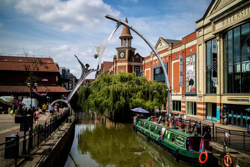 Lincoln, United Kingdom - 07/21/2018: The River Witham going through the centre of Lincoln, with the empowerment sculpture in. Background stock photo