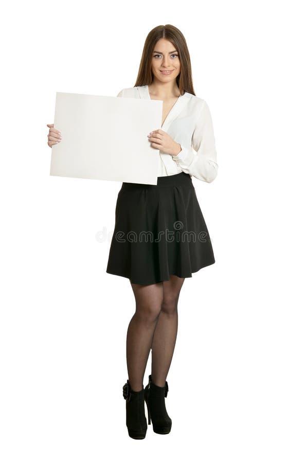 Linda mulher e cartaz branco ou espaço livre para slogan ou texto, isolada imagens de stock